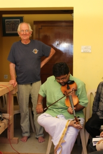 Ananthakrishnan holds the violin with his toe
