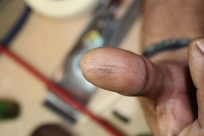 Venkoba is working hard--showing a good case of violin maker thumb.